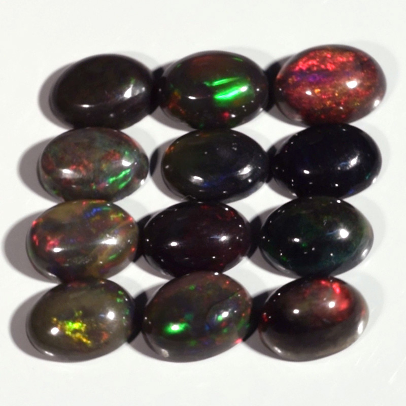 Genuine 100% Natural Set of 12 Cabochon Crystal Welo Black Opals 6.05cts 7.0/6.7 x 5.0mm